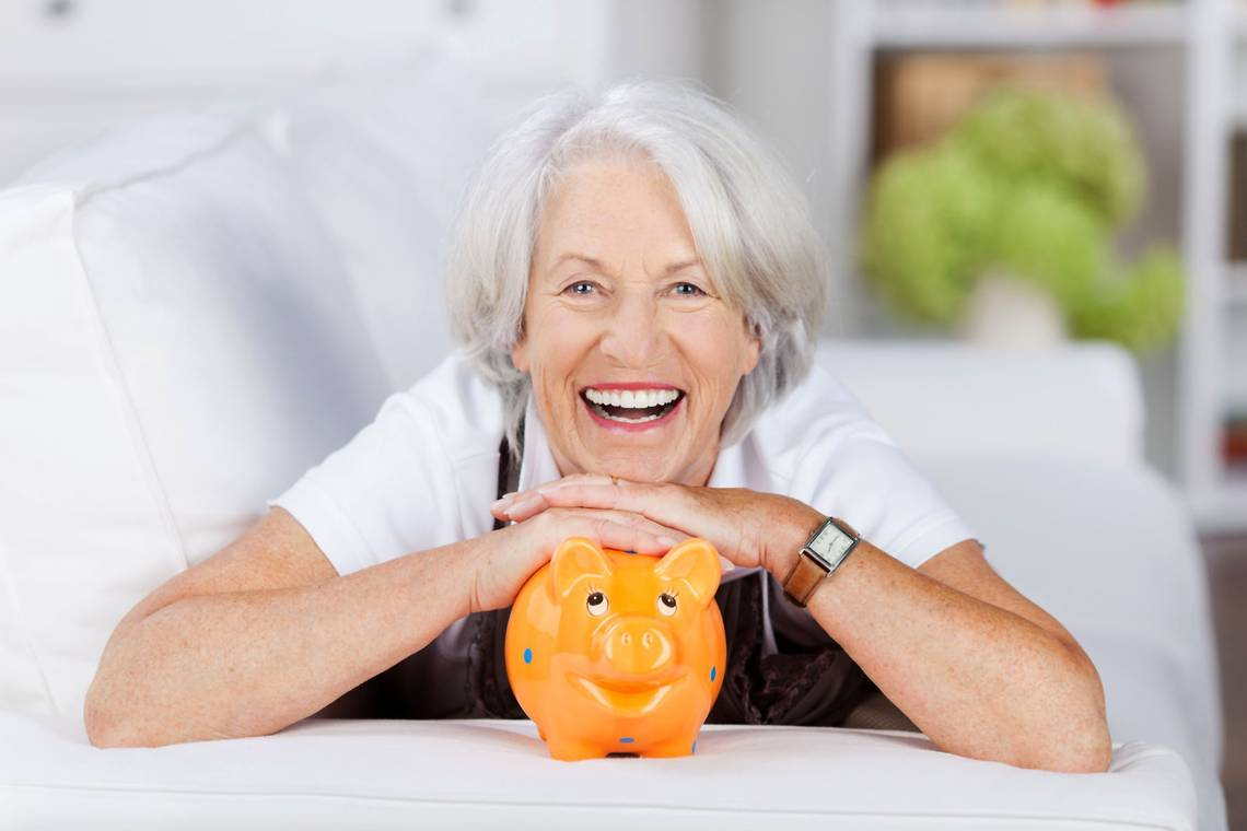 Article 2 Picture 3 senior woman with piggy bank